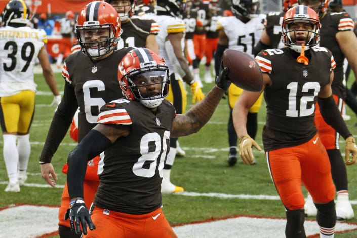 Cleveland Browns wide receiver Jarvis Landry (80) celebrates after scoring a 3-yard touchdown during the second half of an NFL football game against the Pittsburgh Steelers, Sunday, Jan. 3, 2021, in Cleveland. (AP Photo/Ron Schwane)