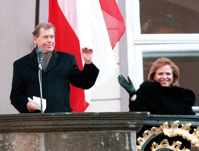 FILE - President Vaclav Havel and his wife Dagmar wave to the crowd of well-wishers from the balcony of Prague Castle after Havel was sworn in for the second term as president of the Czech Republic in this Feb. 2, 1998 file photo. Havel, the dissident playwright who wove theater into politics to peacefully bring down communism in Czechoslovakia and become a hero of the epic struggle that ended the Cold War, died Sunday Dec. 18, 2011 in Prague. He was 75. (AP Photo/Tomas Turek,CTK)
