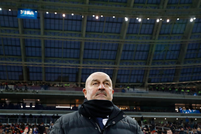 FILE - In this Friday, March 23, 2018 file photo, Russia head coach Stanislav Cherchesov waits for the start of an international friendly soccer match between Russia and Brazil at the Luzhniki stadium in Moscow. (AP Photo/Pavel Golovkin, File)