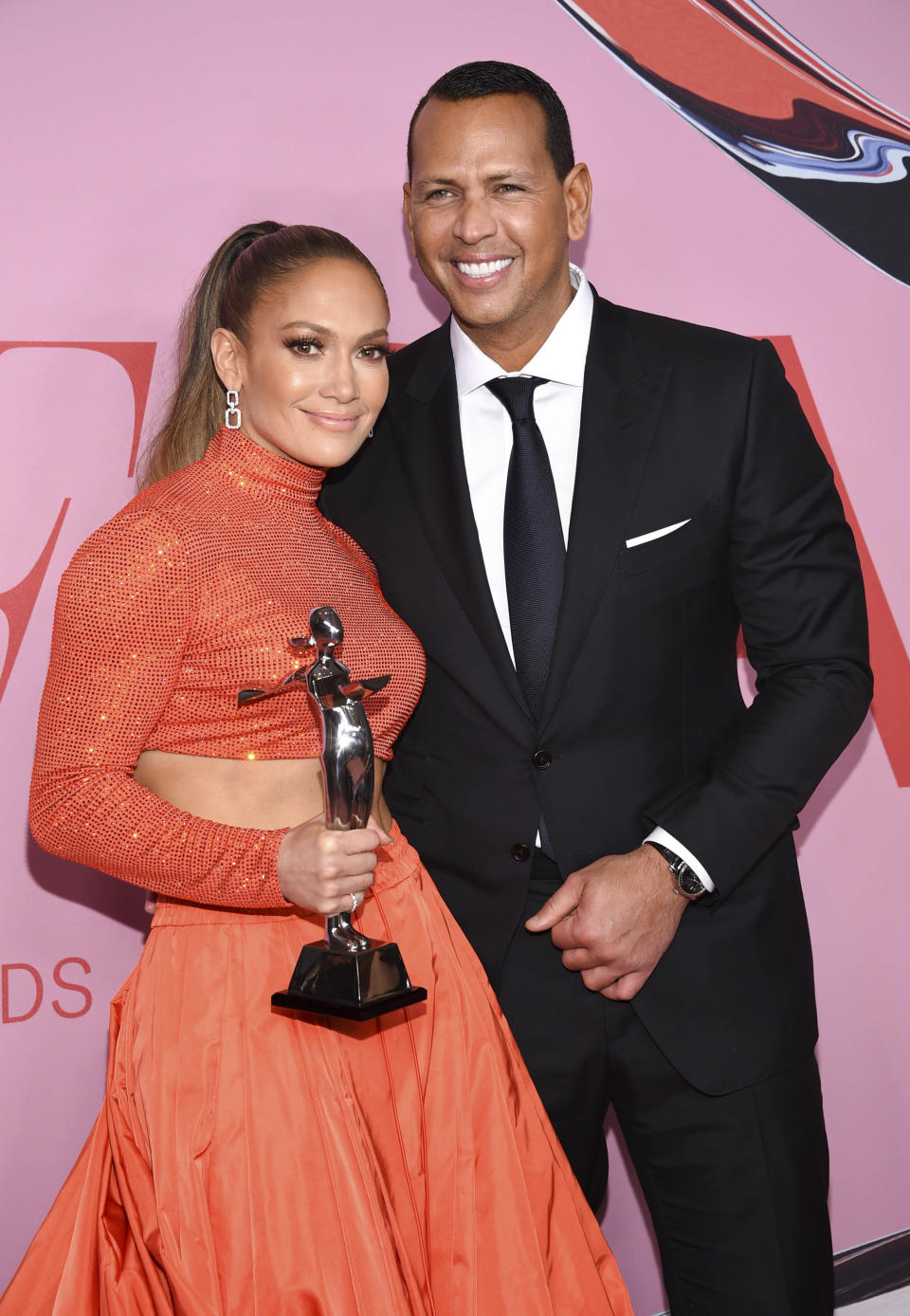 FILE - In this Monday, June 3, 2019, file photo, fashion icon award honoree Jennifer Lopez, left, poses with her fiancé Alex Rodriguez at the CFDA Fashion Awards at the Brooklyn Museum, in New York. Multiple reports based on anonymous sources say Lopez and Rodriguez called off their two-year engagement. The former New York Yankees shortstop proposed to the actor a couple years ago after the celebrity couple started dating in early 2017. (Photo by Evan Agostini/Invision/AP, File)