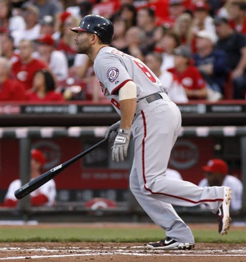 Washington Nationals' Danny Espinosa watches his two-run home run he hit off Cincinnati Reds starting pitcher Mike Leake during the third inning of a baseball game on Friday, May 11, 2012, in Cincinnati. (AP Photo/David Kohl)