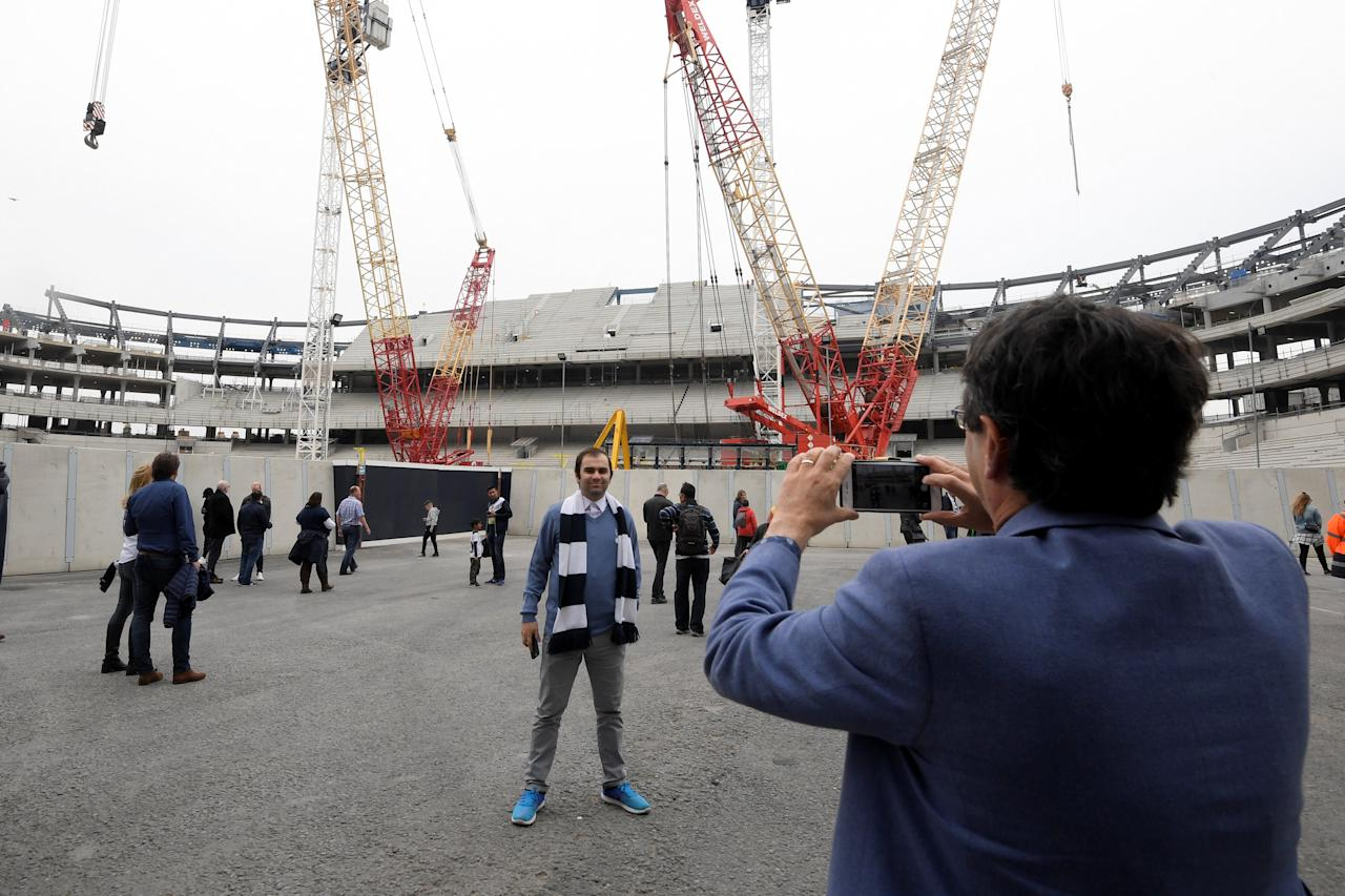 "FILE PHOTO: Britain Football Soccer - Tottenham Hotspur v Arsenal - Premier League - White Hart Lane - 30/4/17 General view as a Tottenham fan poses for a picture in the construction of the new stadium Reuters / Toby Melville Livepic/File Photo     EDITORIAL USE ONLY. No use with unauthorized audio, video, data, fixture lists, club/league logos or ""live"" services. Online in-match use limited to 45 images, no video emulation. No use in betting, games or single club/league/player publications.  Please contact your account representative for further details."