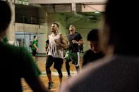 Cameroon's Benoit Mbala (centre, dark shirt) warms up with fellow college team members at De La Salle University's gym in Manila on January 24, 2017 (AFP Photo/Noel CELIS)
