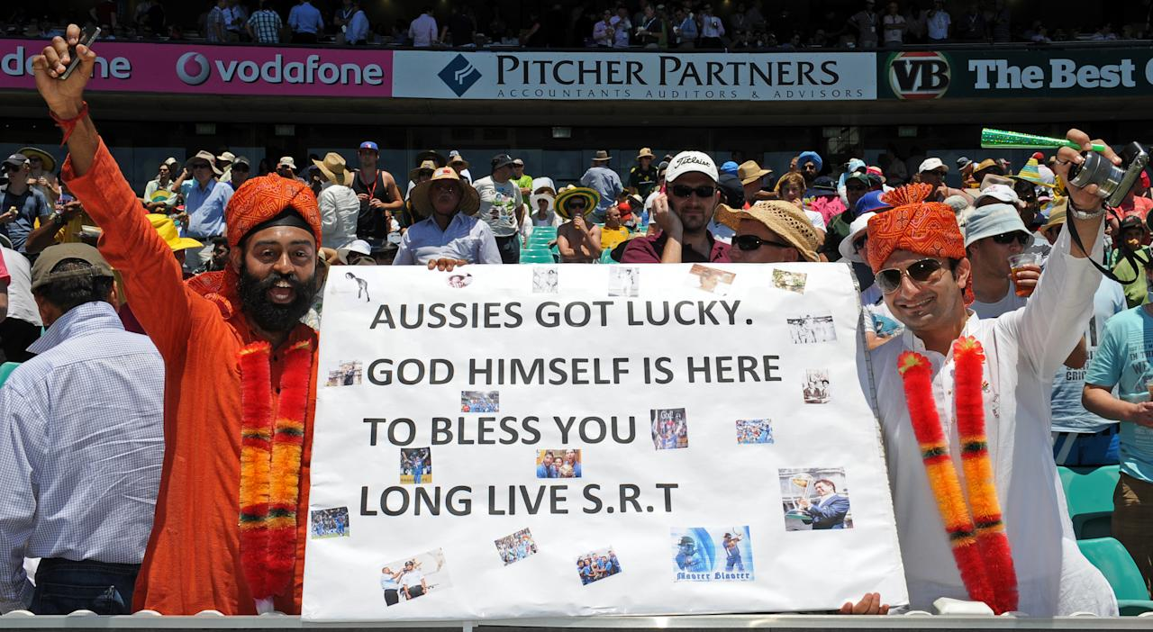 Supporters of the legendary Indian batsmen Sachin Tendulkar await his historic 100th century during the second cricket Test against Australia and the 100th Test at the Sydney Cricket Ground (SCG) on January 3, 2012.    IMAGE STRICTLY RESTRICTED TO EDITORIAL USE - STRICTLY NO COMMERCIAL USE      AFP PHOTO / Torsten BLACKWOOD (Photo credit should read TORSTEN BLACKWOOD/AFP/Getty Images)