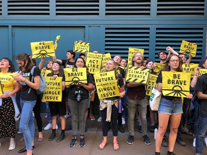 Sunrise Movement activists lobbied for a candidate debate focused solely on climate change outside the DNC's meeting Friday in San Francisco. (Photo: Sarah Ruiz-Grossman/HuffPost )