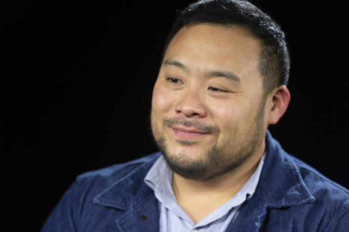 """This Oct. 23, 2019 photo shows celebrity chef David Chang during an interview in Los Angeles to promote his Netflix series """"Breakfast, Lunch & Dinner"""". (AP Photo/Damian Dovarganes)"""