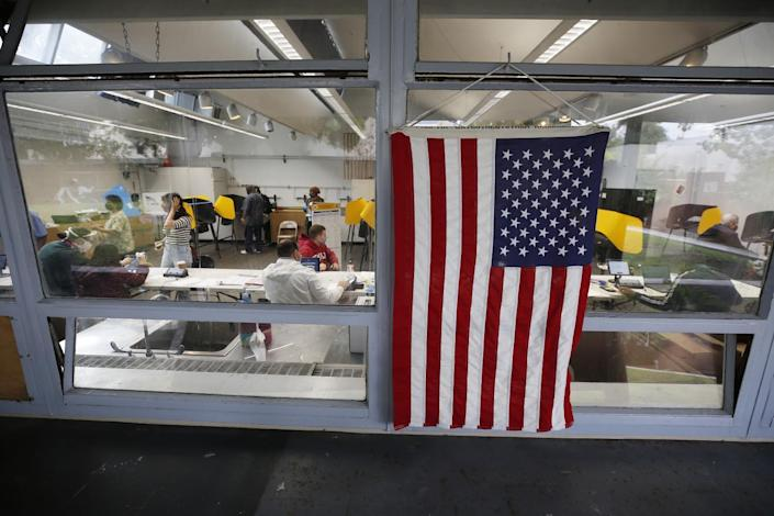 An American flag hangs in the window of a vote center