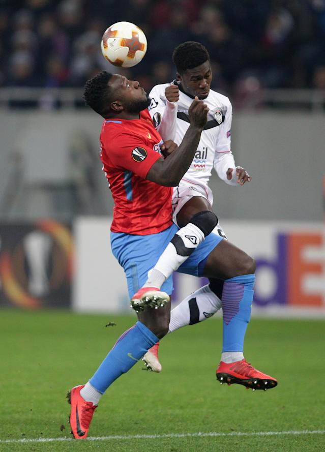 Soccer Football - Europa League - Steaua Bucharest vs FC Lugano - National Arena, Bucharest, Romania - December 7, 2017 Steaua Bucharest's Harlem Gnohere in action with Lugano's Guy Eloge Koffi Yao Inquam Photos/Octav Ganea via REUTERS ROMANIA OUT. NO COMMERCIAL OR EDITORIAL SALES IN ROMANIA THIS IMAGE HAS BEEN SUPPLIED BY A THIRD PARTY. IT IS DISTRIBUTED, EXACTLY AS RECEIVED BY REUTERS, AS A SERVICE TO CLIENTS