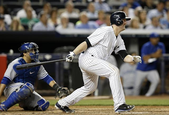 New York Yankees Brian McCann hits a seventh-inning, three-run triple off Toronto Blue Jays reliever Brett Cecil in a baseball game at Yankee Stadium in New York, Wednesday, June 18, 2014. (AP Photo/Kathy Willens)