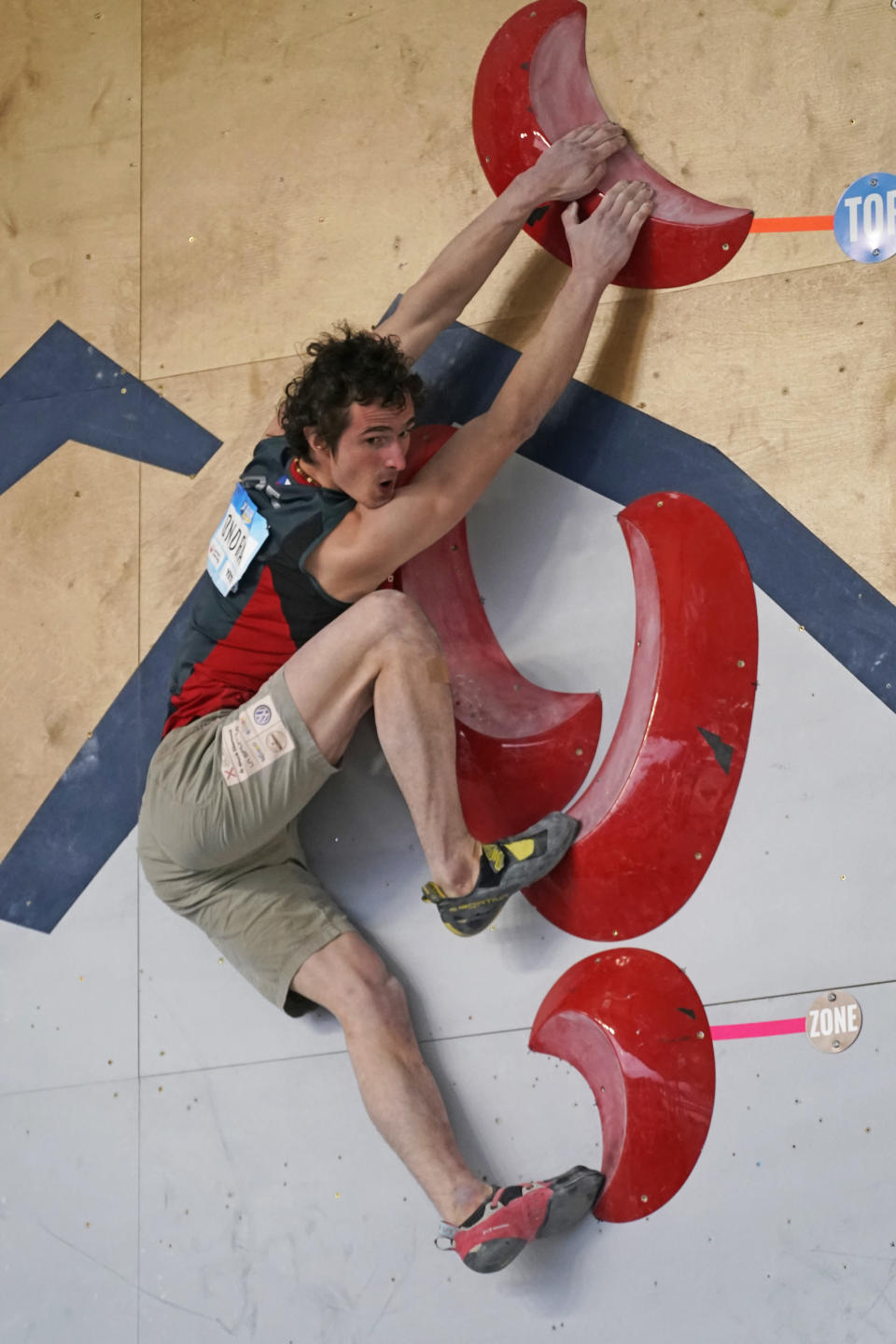 FILE - Adam Ondra, of the Czech Republic, climbs during the men's boulder finals at the climbing World Cup in Salt Lake City, in this May 22, 2021, file photo. Climbing has always been a niche sport among outdoor enthusiasts. Inclusion in the 2021 Tokyo Olympics will take it mainstream and the world will see just how difficult it is clinging to tiny hand holds with fingers and toes. (AP Photo/Rick Bowmer, File)