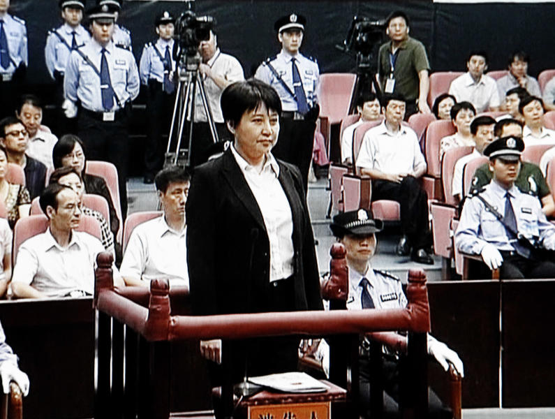 This video image taken from CCTV shows Gu Kailai, center, the wife of disgraced politician Bo Xilai, standing trial in the Intermediate People's Court in the eastern Chinese city of Hefei Thursday Aug. 9, 2012. According to testimony Thursday in one of China's highest-profile murder trials in years, Gu lured British businessman Neil Heywood to a hotel in the southwestern mega-city of Chongqing, where she got him drunk and fed him poison. The secretive trial of Gu and a household aide, who are accused of murdering Bo family associate Heywood, ended in less than a day at the court. (AP Photo/CCTV via APTN) CHINA OUT, TV OUT