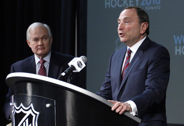 FILE - In this Jan. 24, 2015, file photo, NHL Commissioner Gary Bettman, right, and NHL Player's Association Executive Director Donald Fehr take part in announcing the return of the World Cup of Hockey in 2016 in Toronto, during a news conference at Nationwide Arena in Columbus, Ohio. With labor talks having already begun on an informal basis, NHL Commissioner Bettman and union chief Fehr are in agreement in their desire to reboot the World Cup of Hockey tournament. The stumbling block to laying out a long-term calendar of international competition, however, revolves around the hot-button topic of the NHL returning to participate in the Winter Olympics after skipping out on South Korea in 2018. (AP Photo/Gene J. Puskar, File)