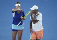 Rajeev Ram of the US and Barbora Krejcikova of the Czech Republic chat in their match against Australia's Samantha Stosur and Matthew Ebden in the mixed doubles final at the Australian Open tennis championship in Melbourne, Australia, Saturday, Feb. 20, 2021.(AP Photo/Hamish Blair)