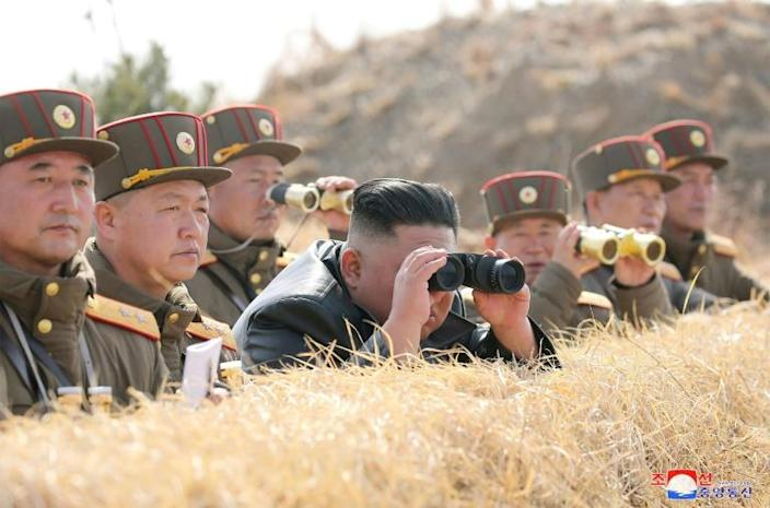 "North Korean state media said Kim oversaw an ""artillery fire competition"" among combined units of the army -- the day before he observed demonstration fire of a ""tactical guided weapon"" (AFP Photo/STR)"