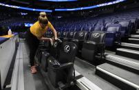 A worker cleans the seats after the announcement of the cancellation of the SEC Basketball Tournament at Bridgestone Arena on March 12, 2020 in Nashville, Tennessee. The tournament has been cancelled due to the growing concern about the spread of the Coronavirus (COVID-19). The NCAA tournament has also been cancelled. (Photo by Andy Lyons/Getty Images)