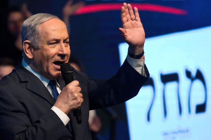 Israeli Prime Minister Benjamin Netanyahu speaks to his supporters as he campaigns at a Likud party rally ahead of the upcoming election, in Ramat Gan