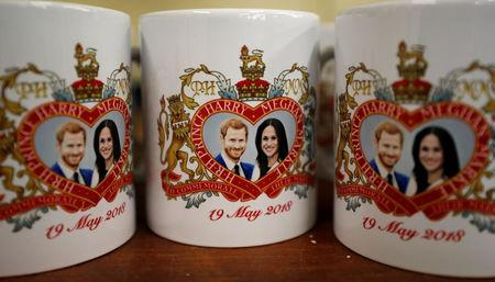 Mugs commemorating the wedding of Britain's Prince Harry and Meghan Markle are seen at the Prince William Pottery Company in Liverpool.