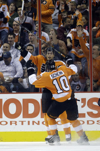 Philadelphia Flyers' Brayden Schenn (10) celebrates with Vincent Lecavalier after Schenn's goal during the first period of an NHL hockey game against the Florida Panthers, Tuesday, Oct. 8, 2013, in Philadelphia. (AP Photo/Matt Slocum)