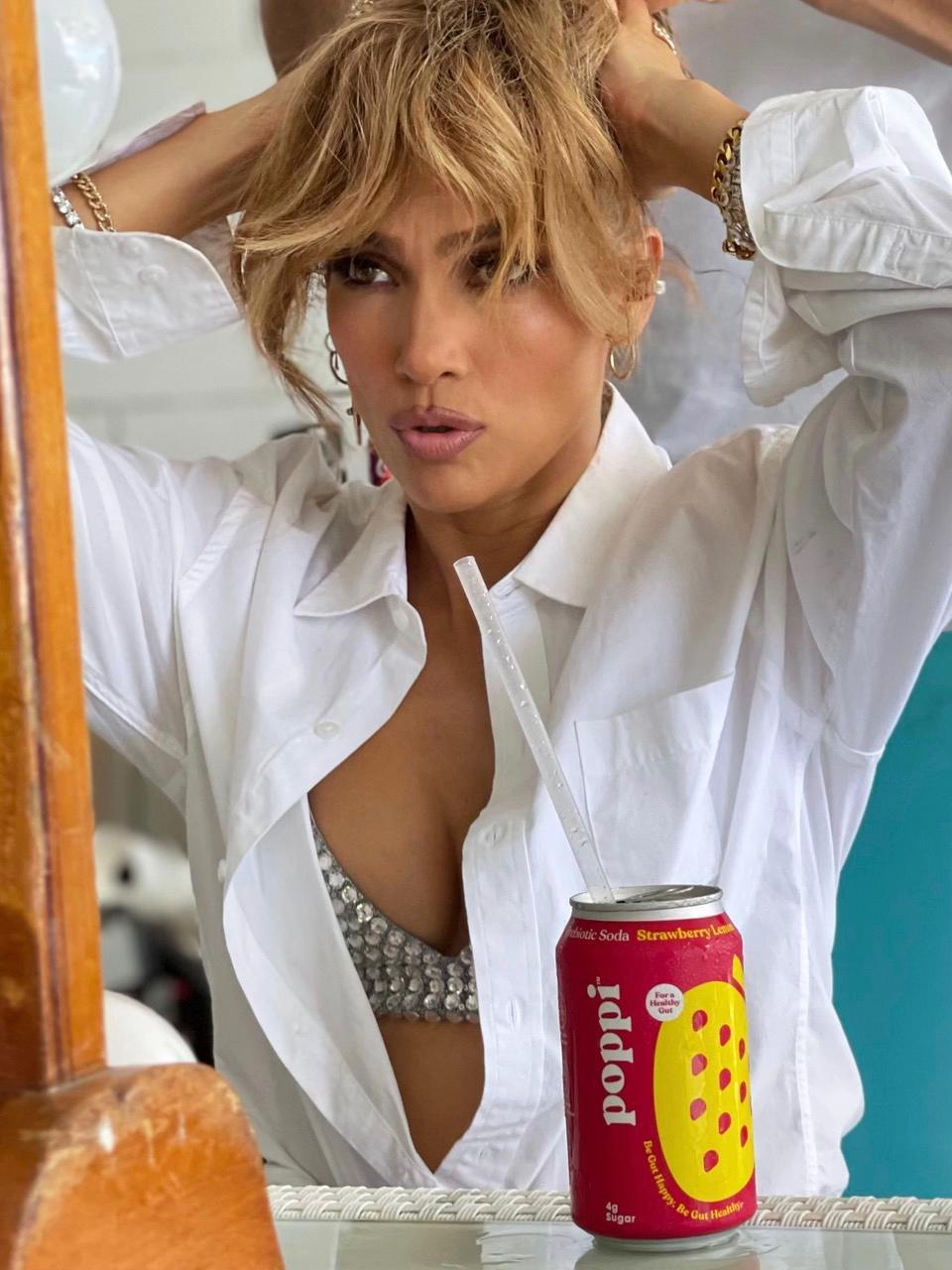 """<p>Jennifer Lopez shows off her love for Poppi on the set of her latest music video """"Cambia El Paso"""" with Rauw Alejandro.</p>"""