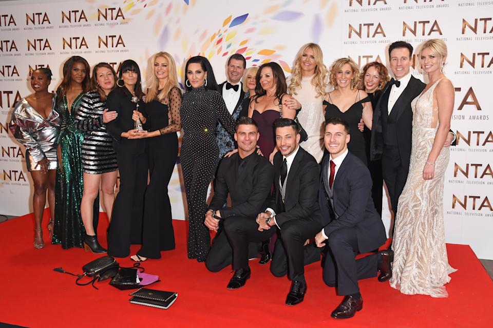 """LONDON, ENGLAND - JANUARY 28: Motsi Mabuse, Oti Mabuse, Claudia Winkleman, Tess Daly, Michelle Visage, Aljaz Skorjanec, Giovanni Pernice, Gorka Marquez, Anton du Beke and Nadiya Bychkova, accepting the Best Talent Show for """"Strictly Come Dancing"""", pose in the winners room at the National Television Awards 2020 at The O2 Arena on January 28, 2020 in London, England. (Photo by David M. Benett/Dave Benett/Getty Images)"""