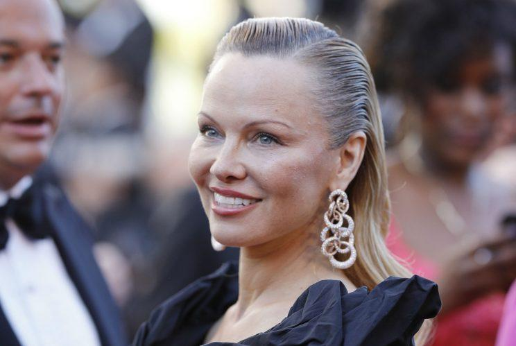 Unrecognisable… Baywatch star Pamela Anderson pitches up in Cannes – Credit: Getty
