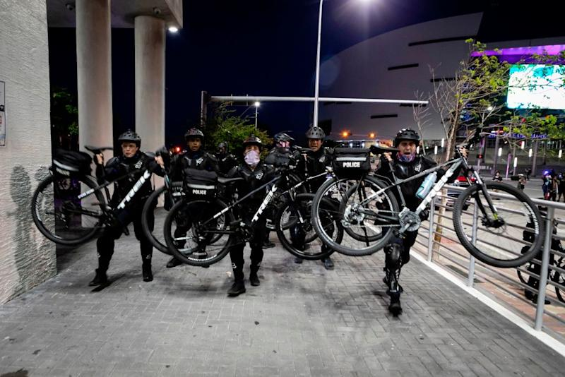 Police officers use their bicycles to control the crowd during a demonstration in response to the recent death of George Floyd in police custody in Minneapolis in Miami Florida on May 31 2020 Thousands of National Guard troops patrolled major US cities after five consecutive nights of protests over racism and police brutality that boiled over into arson and looting sending shock waves through the country The death Monday of an unarmed black man George Floyd at the hands of police in Minneapolis ignited this latest wave of outrage in the US over law enforcements repeated use of lethal force against African Americans this one like others before captured on cellphone video Photo by Eva Marie UZCATEGUI AFP Photo by EVA MARIE UZCATEGUIAFP via Getty Images