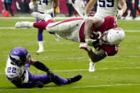 Minnesota Vikings free safety Harrison Smith (22) upends Arizona Cardinals tight end Maxx Williams (87) during the second half of an NFL football game, Sunday, Sept. 19, 2021, in Glendale, Ariz. (AP Photo/Rick Scuteri)
