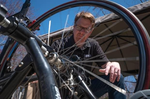 High school physics teacher Shane MacLeod has been filming lessons for his students on the porch of his Dartmouth, N.S., home, including one that used a bicycle wheel to demonstrate torque.