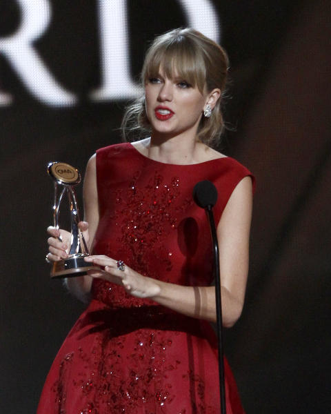 Taylor Swift accepts the Pinnacle award at the 47th annual CMA Awards at Bridgestone Arena on Wednesday, Nov. 6, 2013, in Nashville, Tenn. (Photo by Wade Payne/Invision/AP)