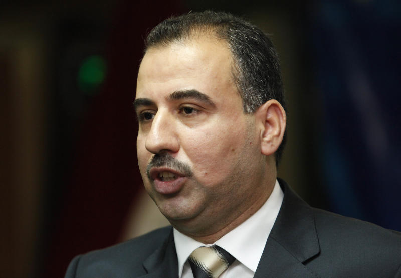 FILE - In this Thursday, April 29, 2010 file photo, Karim al-Tamimi, a member of the Independent High Electoral Commission speaks to reporters in Baghdad, Iraq. Two Iraqi election officials said Friday they have been detained after authorities reopened a corruption case against them, a move they dismiss as an effort to pressure the panel. Faraj al-Haidari, chief of Iraq's electoral commission, said by phone Friday he is currently held at a police station after a judge's decision to reinvestigate old corruption charges against the commission. Commission official Karim al-Tamimi says he was also detained. The two spoke over cell phones to reporters. (AP Photo/Hadi Mizban,File)