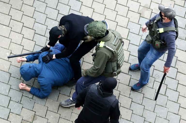 Security forces detain a man during the latest opposition rally in the capital Minsk against the Belarus presidential election three months ago. The opposition leader in exile says she hopes to soon meet with US President-elect Joe Biden.