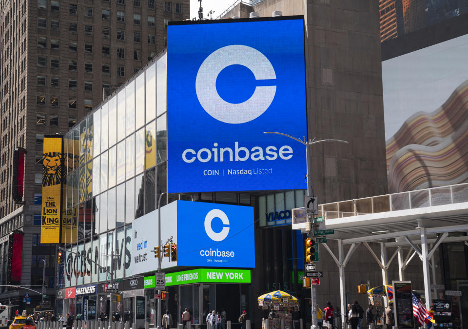 NEW YORK, NY - APRIL 14: Monitors display Coinbase signage during the company's initial public offering (IPO) at the Nasdaq market site April 14, 2021 in New York City. Coinbase Global Inc. is the largest U.S. cryptocurrency exchange, debuting today through a rare direct listing.  (Photo by Robert Nickelsberg/Getty Images)