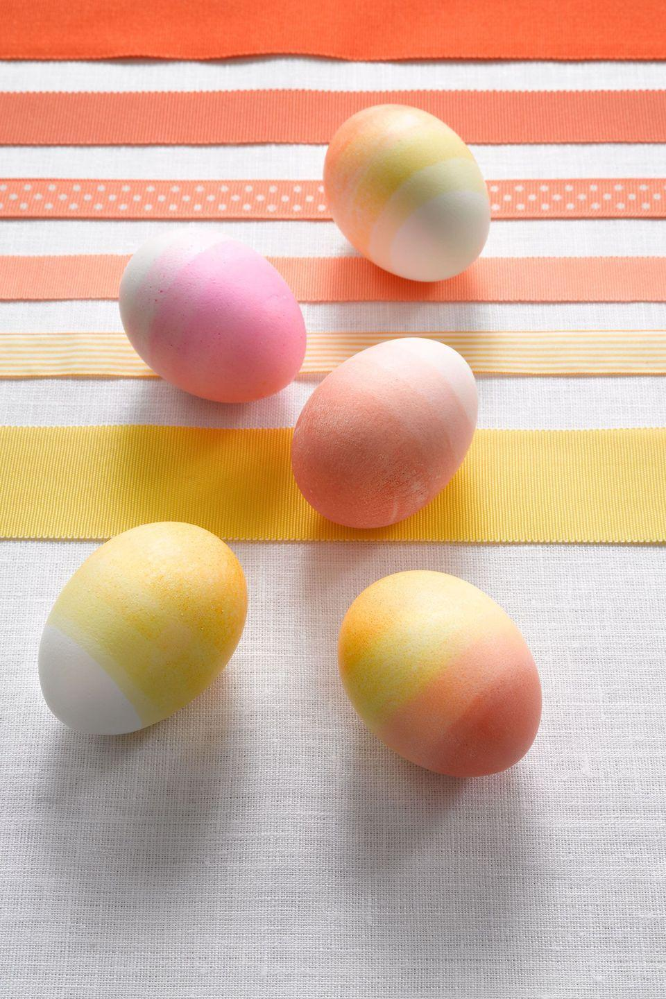 """<p><strong>Materials:</strong></p><p>•Gel/paste food coloring (approximately $2 each at craft and baking supply stores)</p><p>•White vinegar</p><p>•1 dozen white hard-boiled eggs</p><p><strong>Directions:</strong></p><p><strong>1.</strong> Mix colors using ⅓ tsp (¼ tsp for yellow) food coloring, enough warm water to cover eggs and 1 tsp white vinegar.</p><p><strong>2.</strong> Dip egg fully in dye and let dry.</p><p><strong>3. </strong>Dip the egg again ¾ of the way into the dye and let dry. Repeat in quarterly increments.</p><p><strong>Optional:</strong> You can also start by leaving the tip of the egg white. To create a multicolor gradation, start with one color and dip in quarterly increments. At the half mark, begin dipping by quarters in another color.</p><p><strong><a class=""""link rapid-noclick-resp"""" href=""""https://www.amazon.com/Chefmaster-Liqua-Gel-Natural-Coloring-Decorating/dp/B07KGHVFKM/?tag=syn-yahoo-20&ascsubtag=%5Bartid%7C10070.g.1751%5Bsrc%7Cyahoo-us"""" rel=""""nofollow noopener"""" target=""""_blank"""" data-ylk=""""slk:SHOP EASTER EGG DYE"""">SHOP EASTER EGG DYE</a></strong></p>"""