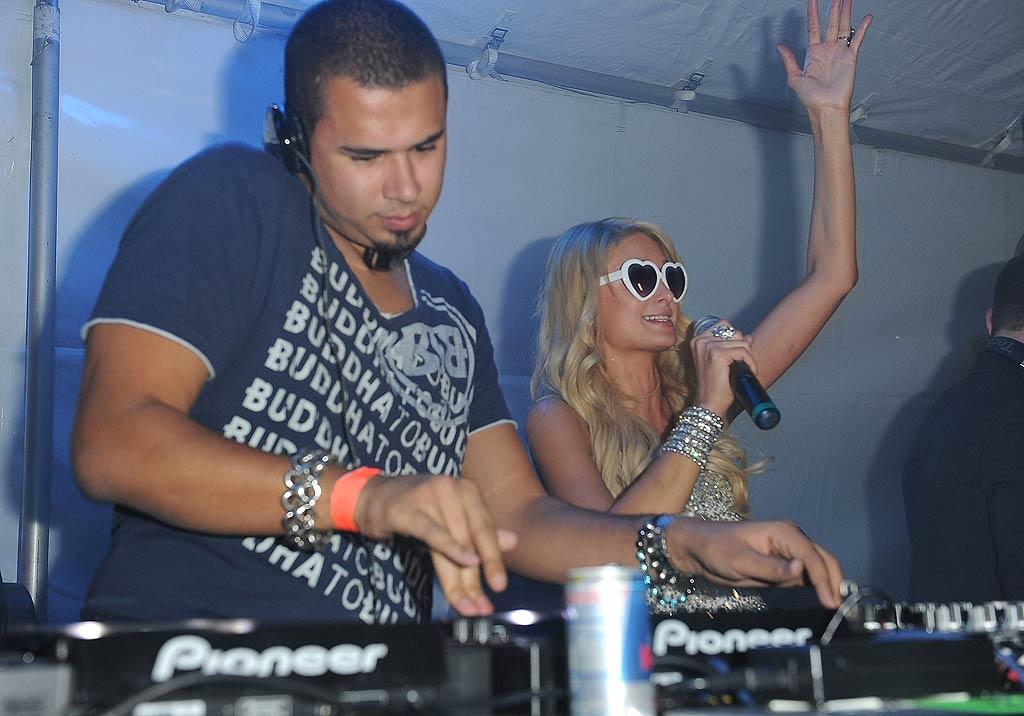 Paris was ready to raise the roof with a little help from DJ Afrojack. (12/07/2011)