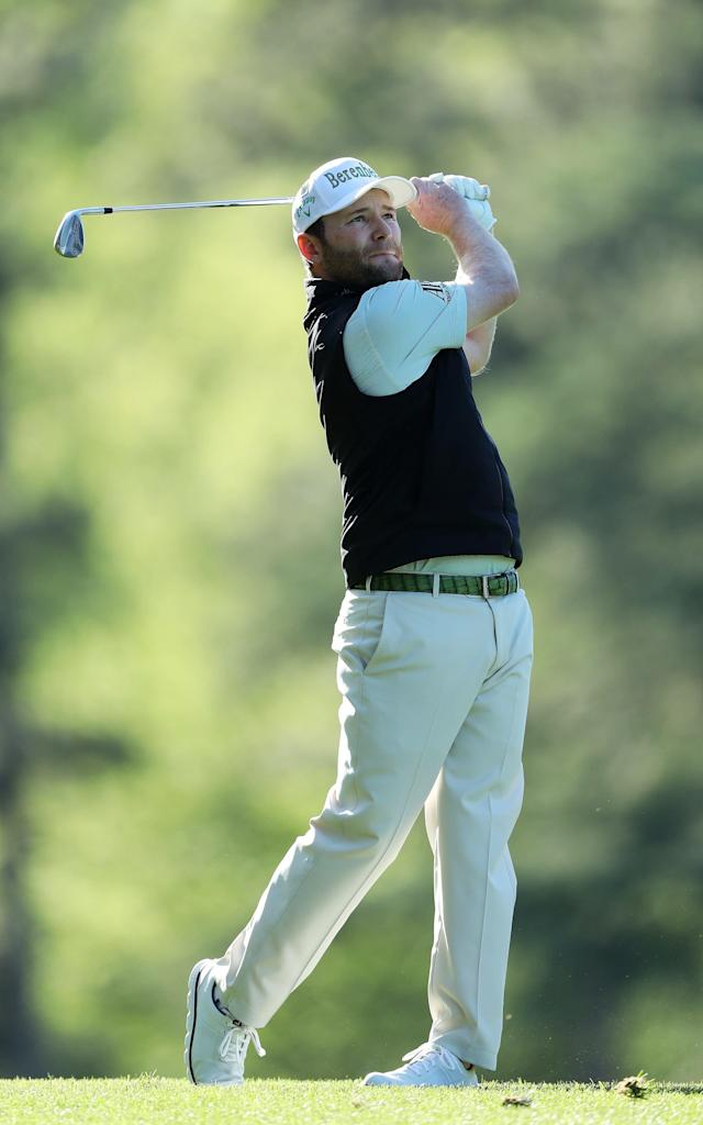 <span>Branden Grace of South Africa swings through his shot on the fairway</span> <span>Credit: David Cannon/Getty Images </span>