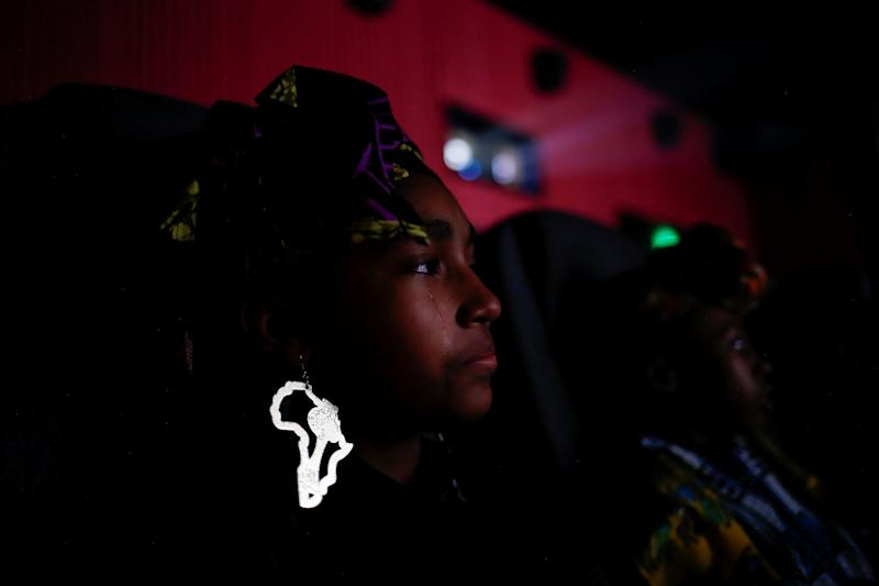 "Destiny Ellington, 12, sheds a tear while watching ""Black Panther."""