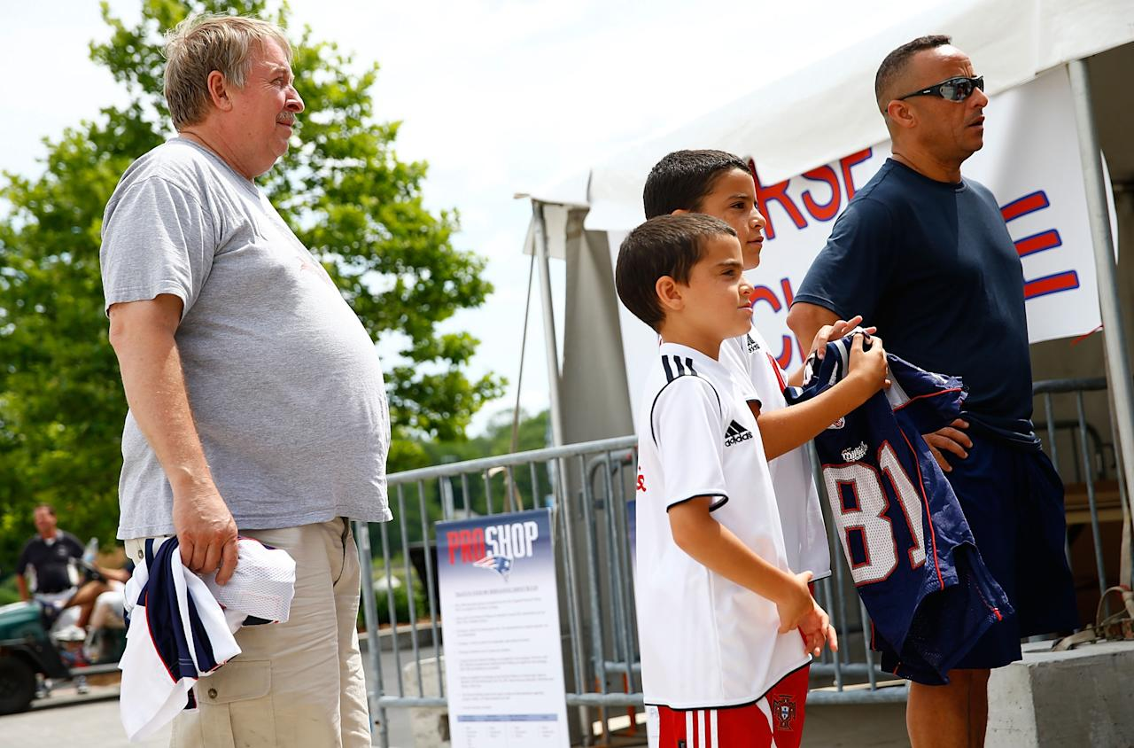 FOXBORO, MA - JULY 7: New England Patriots fans wait in line to trade in their Aaron Hernandez jerseys during a free exchange at the pro shop at Gillette Stadium on July 7, 2013 in Foxboro, Massachusetts. (Photo by Jared Wickerham/Getty Images)