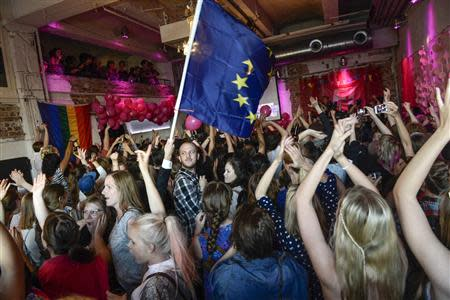 Party workers at the Swedish Feminist Initiative, a feminist political party, celebrate to the exit polls that make the party Sweden's second biggest party in the European Parliament elections, in Stockholm May 25, 2014. REUTERS/Maja Suslin/TT News Agency
