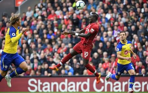Liverpool's Senegalese striker Sadio Mane (C) heads the ball during the English Premier League football match between Liverpool and Southampton at Anfield - Credit: Paul Ellis/Getty Images