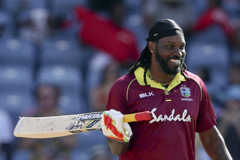 FILE - In this Wednesday, Feb. 27, 2019 file photo, West Indies' Chris Gayle celebrates after scoring a century against West Indies during the fourth One Day International cricket match at the National Stadium in St. George's, Grenada. At 39 and approaching 300 ODIs, the powerful West Indies opener is playing his final World Cup and the last 50-over internationals of his career. (AP Photo/Ricardo Mazalan, File)