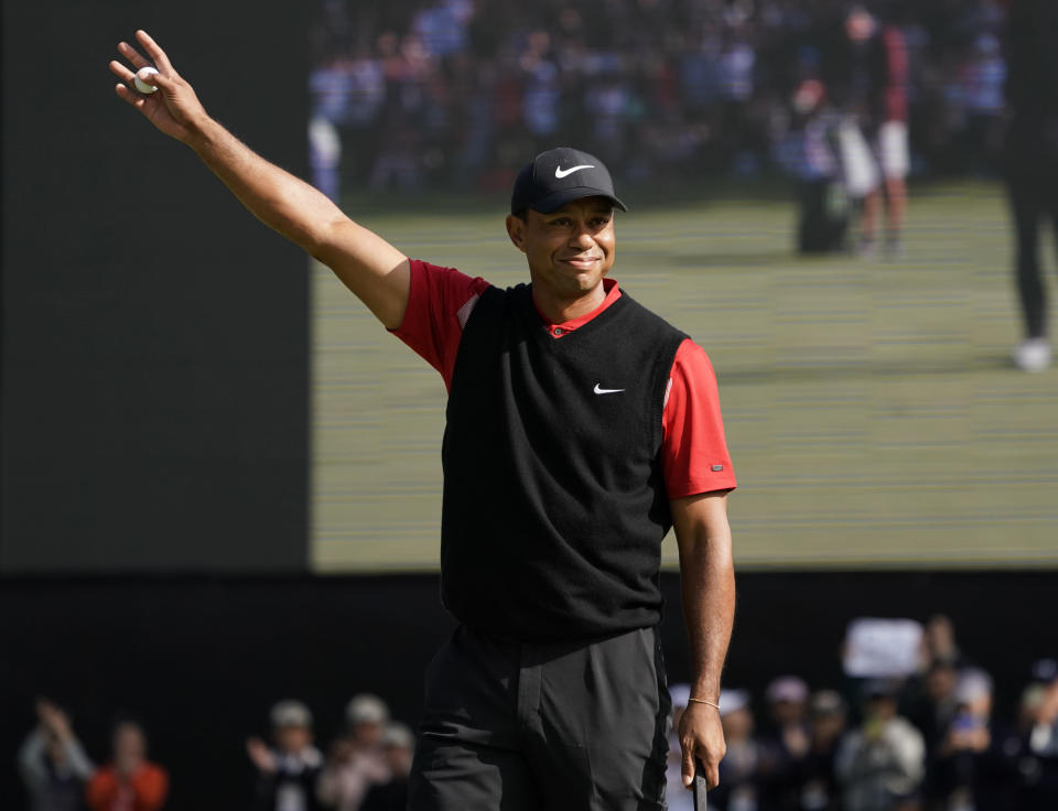 Tiger Woods of the United States celebrates after his putt during the final round of the Zozo Championship PGA Tour at the Accordia Golf Narashino country club in Inzai, east of Tokyo, Japan, Monday, Oct. 28, 2019. (AP Photo/Lee Jin-man)
