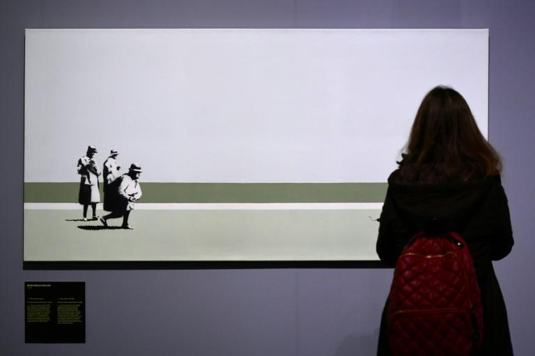 "Curators say the Italian show was organised without Banksy's say-so and was ""very difficult, it was like working with a ghost"""