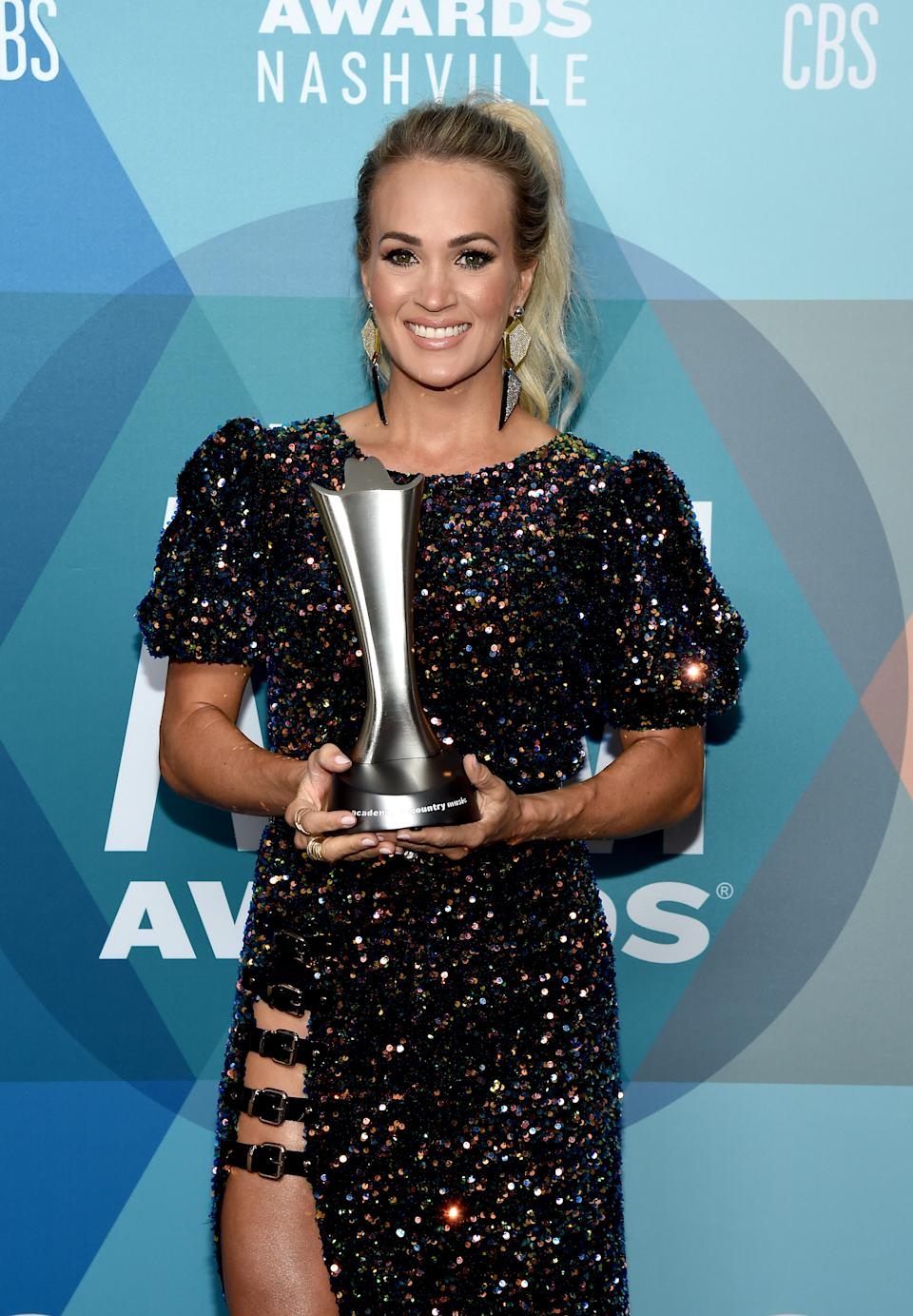 NASHVILLE, TENNESSEE - SEPTEMBER 16: Carrie Underwood poses with the Entertainer of the Year award at the 55th Academy of Country Music Awards at the Grand Ole Opry on September 16, 2020 in Nashville, Tennessee. The ACM Awards airs on September 16, 2020 with some live and some prerecorded segments.   (Photo by John Shearer/ACMA2020/Getty Images for ACM)