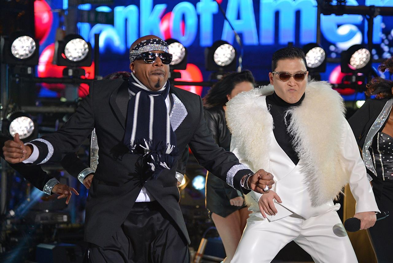 NEW YORK, NY - DECEMBER 31:  Rapper MC Hammer (L), and Korean Rapper PSY perform during New Year's Eve 2013 In Times Square at Times Square on December 31, 2012 in New York City.  (Photo by Mike Coppola/Getty Images)