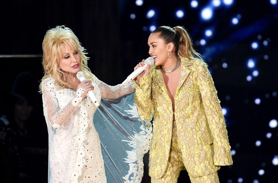<p>Miley Cyrus and Dolly are actually (kind of) related. Miley's country singer dad named Dolly as Miley's godmother, and the two have been close ever since.</p>
