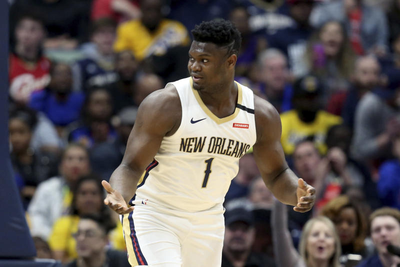 New Orleans Pelicans forward Zion Williamson (1) reacts after a basket in the first half of an NBA basketball game in New Orleans, Sunday, March 1, 2020. (AP Photo/Rusty Costanza)