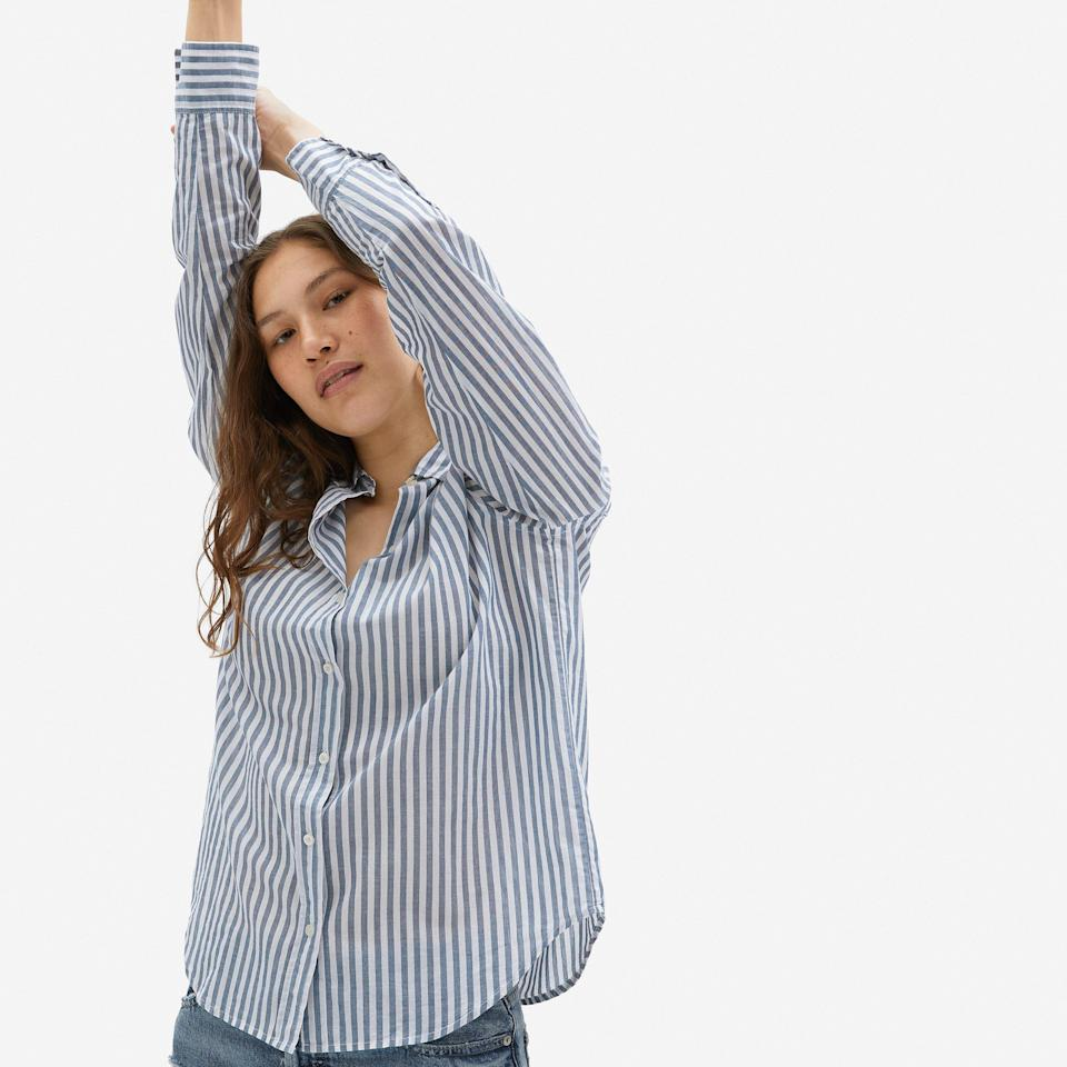"""<p><strong>everlane</strong></p><p>everlane.com</p><p><strong>$50.00</strong></p><p><a href=""""https://go.redirectingat.com?id=74968X1596630&url=https%3A%2F%2Fwww.everlane.com%2Fproducts%2Fwomens-air-relaxed-shirt-blue-white&sref=https%3A%2F%2Fwww.goodhousekeeping.com%2Fclothing%2Fg33473194%2Ftransitional-clothing-summer-to-fall%2F"""" rel=""""nofollow noopener"""" target=""""_blank"""" data-ylk=""""slk:Shop Now"""" class=""""link rapid-noclick-resp"""">Shop Now</a></p><p>A classic button-up shirt — like this super-chic one from Everlane — makes for a great fall transition piece since it's a lightweight top you can easily dress up or down. Layer it with your favorite <a href=""""https://www.goodhousekeeping.com/beauty/fashion/g28213834/best-fall-jackets-for-women/"""" rel=""""nofollow noopener"""" target=""""_blank"""" data-ylk=""""slk:fall jacket"""" class=""""link rapid-noclick-resp"""">fall jacket</a> if it's cool outside, or just throw it on with a pair of jeans and roll the sleeves up for a more casual and summery look.</p>"""