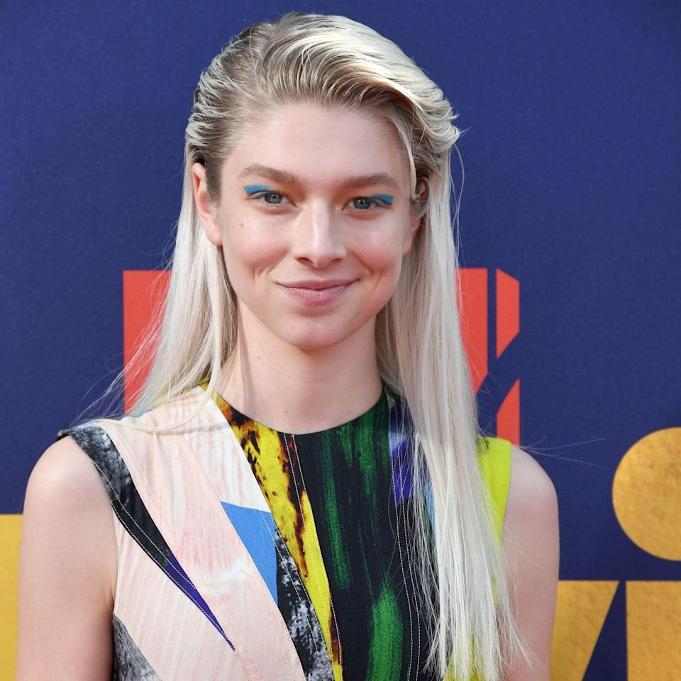 """<em>Euphoria</em> star Hunter Schafer also favors the one-length cut. """"It will be making a huge comeback in the year coming,"""" says Ellis. """"It's a super simple cut that gives a bold statement. I give this haircut to my girls who want to leave their hair long without the fuss of layers. It's also my favorite haircut come summer because you can put every piece in a ponytail with no issue."""""""