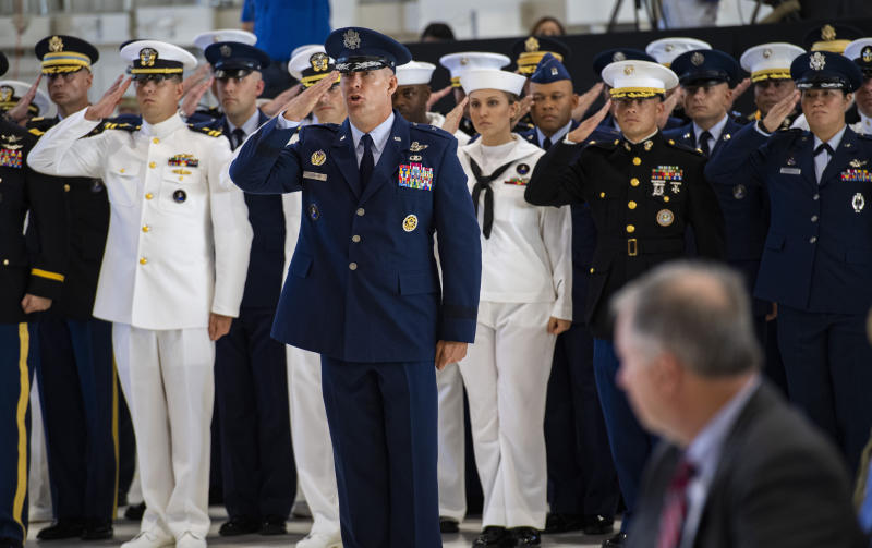 U.S. Space Command Chief of Staff, Brig. Gen. Brook Leonard, and the rest of his staff give their first salute to Commander Gen. John W. Raymond Monday, Sept. 9, 2019, during a ceremony to recognize the establishment of the United States Space Command at Peterson Air Force Base in Colorado Springs, Colo. (Christian Murdock/The Gazette via AP)