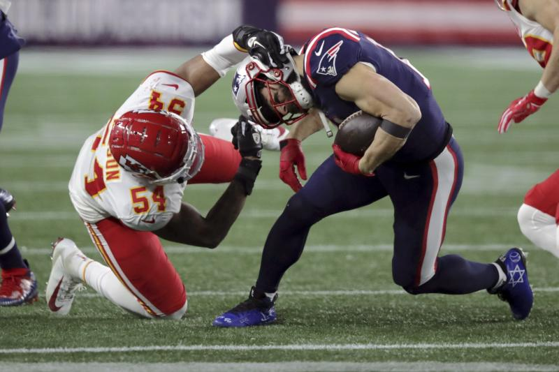 Kansas City Chiefs linebacker Damien Wilson, left, tackles New England Patriots wide receiver Julian Edelman in the second half of an NFL football game, Sunday, Dec. 8, 2019, in Foxborough, Mass. (AP Photo/Charles Krupa)